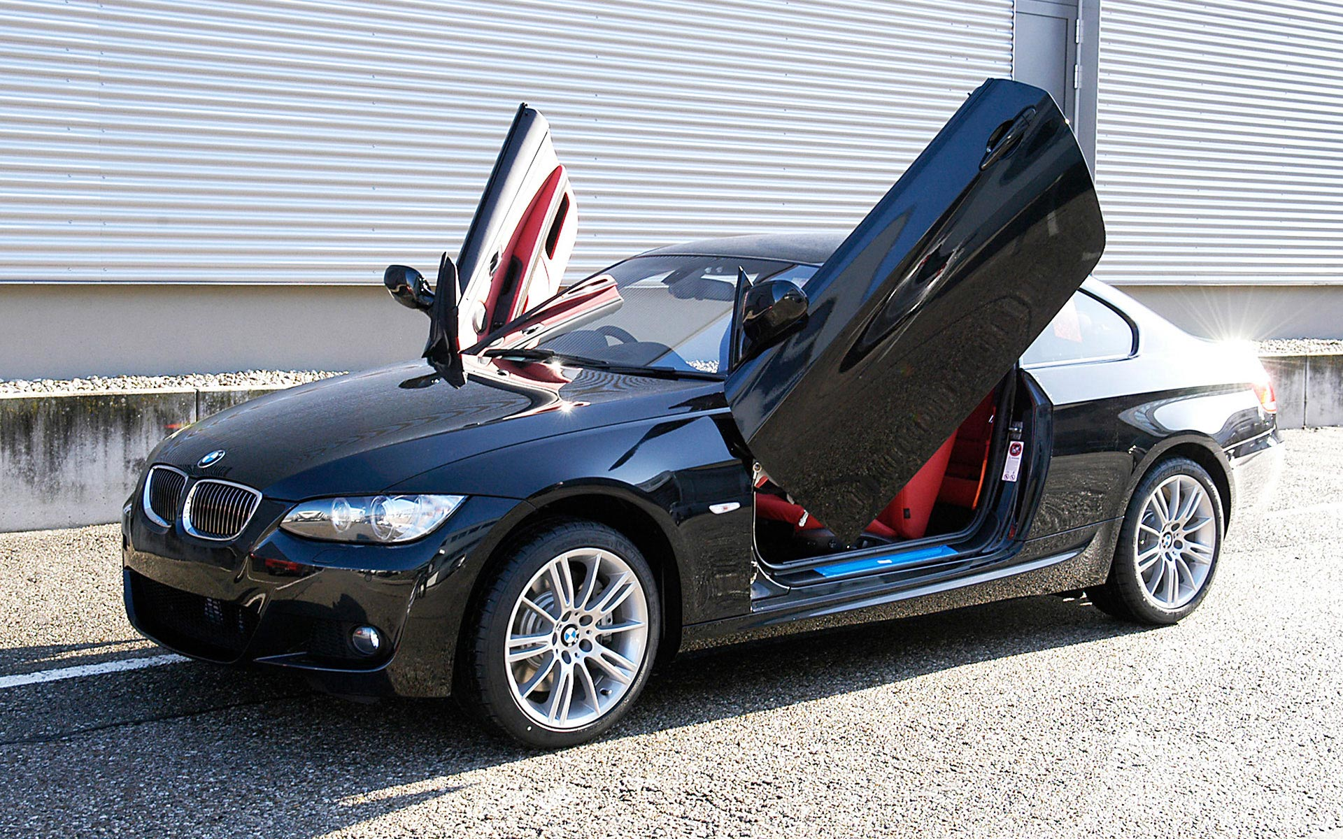 A customised BMW 335i with M Sport Package and gull wing doors