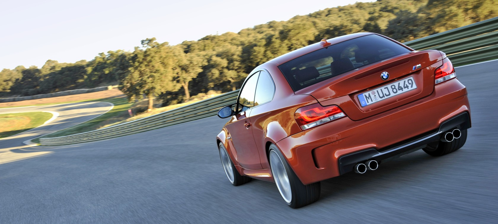 BMW 1 Series M Coupé driving on a race track