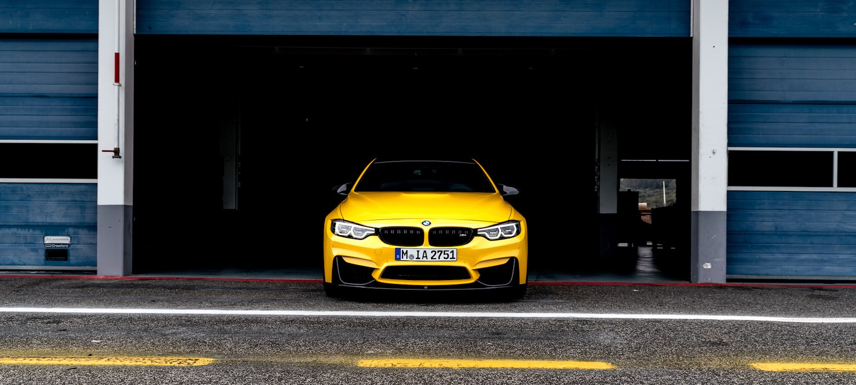 BMW M4 Coupé Speed Yellow with M Perfomance Parts