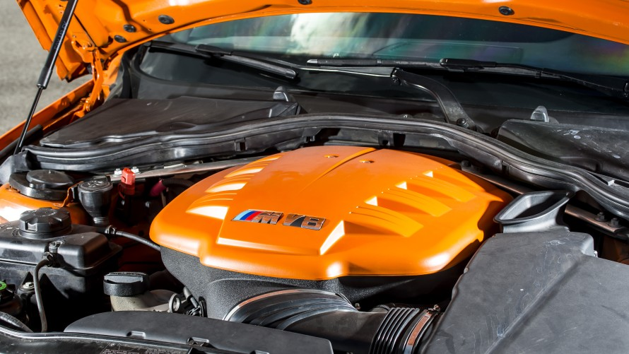 BMW M3 GTS engine compartment with V8 and orange cover