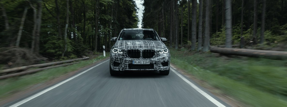 The BMW X5 M prototype on a narrow road in the Eifel mountains