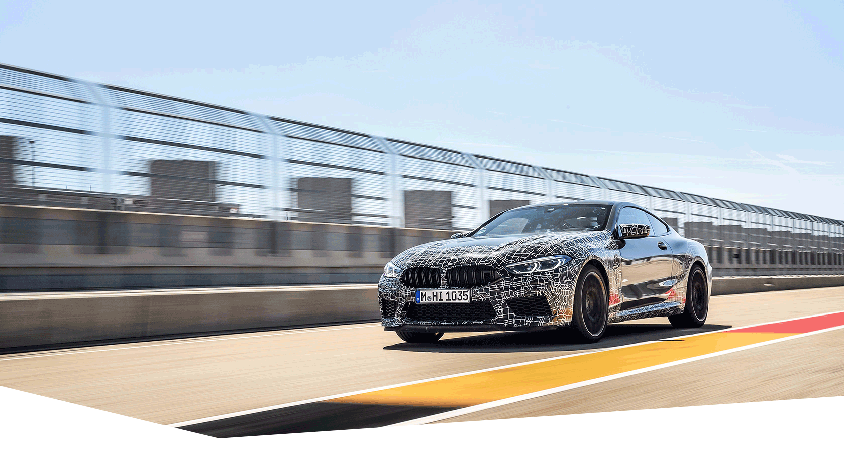 New BMW M8 Coupé with camouflage on a race track