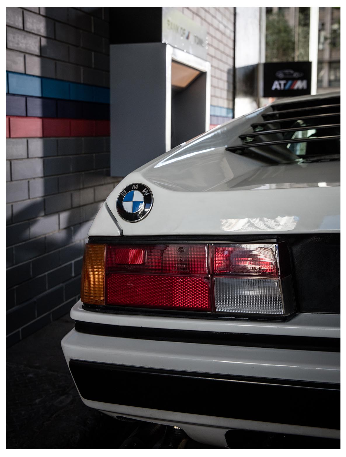 "Rear light of the BMW M1 in cream white in ""Banking in BMW M TOWN"" film"